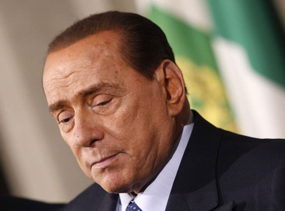 Silvio Berlusconi talks to journalists after a meeting with Italian President Giorgio Napolitano in February 2014.