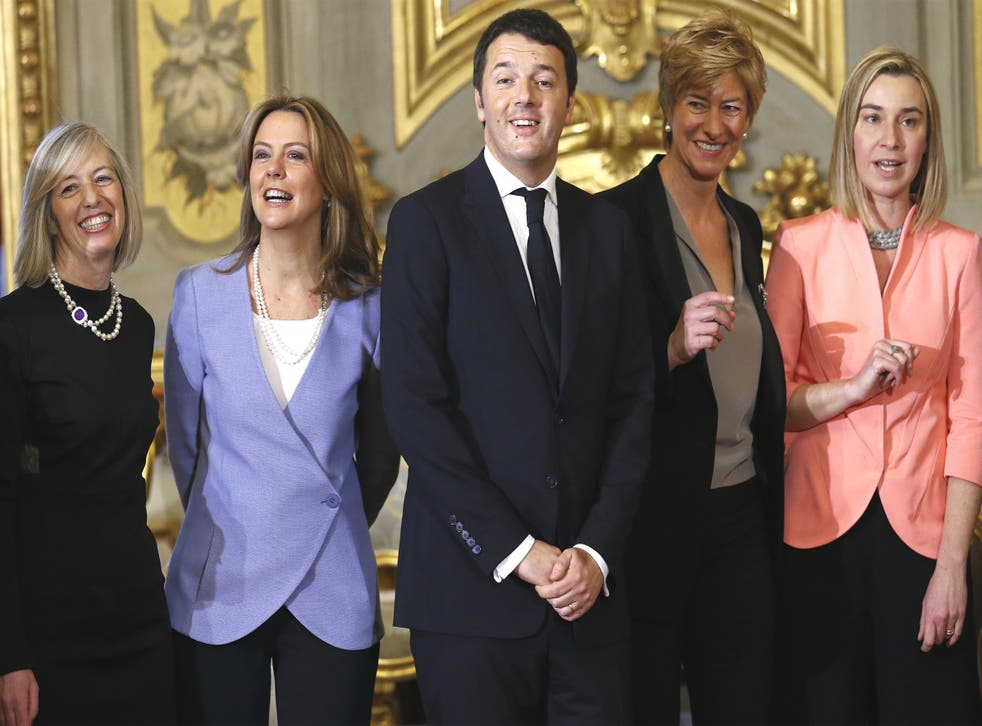 Matteo Renzi (centre) posing with his new ministers (from left) for education, Stefania Giannini; health, Beatrice Lorenzin; defence, Roberta Pinotti; and foreign affairs, Federica Mogherini