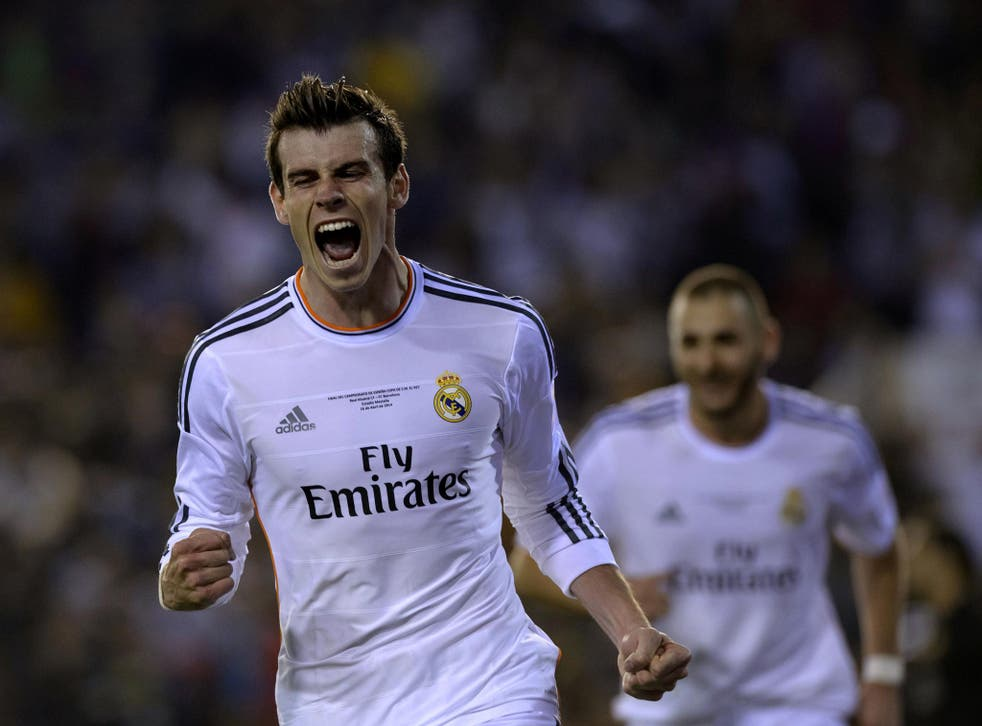 Gareth Bale celebrates his winning goal in the 2-1 Copa del Rey final victory over Barcelona in the Champions League final