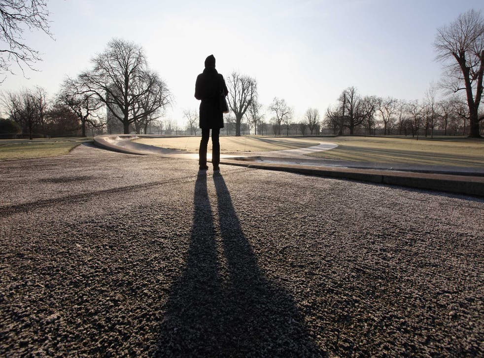 Urban stroller: A woman walks round the Lady Diana memorial in Hyde Park, London