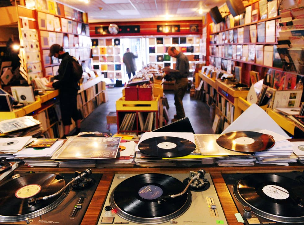 Customers browse through Vinyl Junkies record shop in Berwick Street, Soho, London