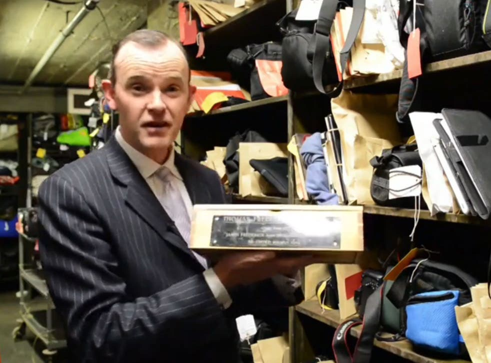 Paul Cowan holds up the box containing the ashes of Thomas Frederick Johnston