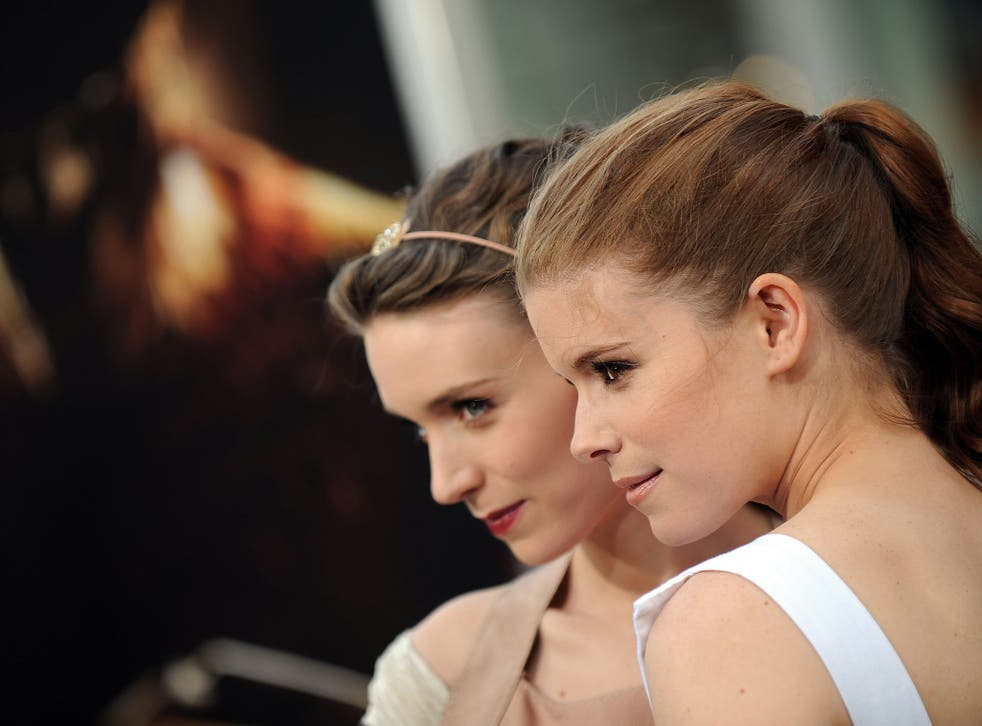 No longer invisible: Kate Mara (left); and with sister Rooney in 2010