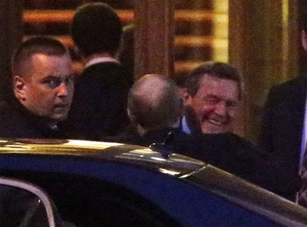Putin and Schroeder embrace in pictures reportedly taken at a 70th birthday party