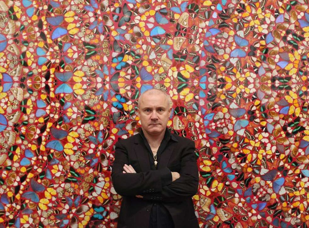 Different strokes: Damien Hirst poses in front of his artwork 'I Am Become Death, Shatterer of Worlds'. The artist appears on the Sunday Times Giving List