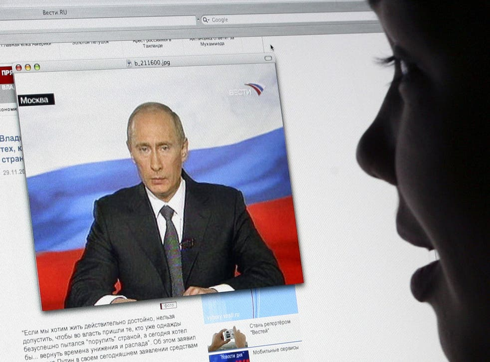 A girl watches Russian President Vladimir Putin's address to the nation on Russsian TV Channel One's website