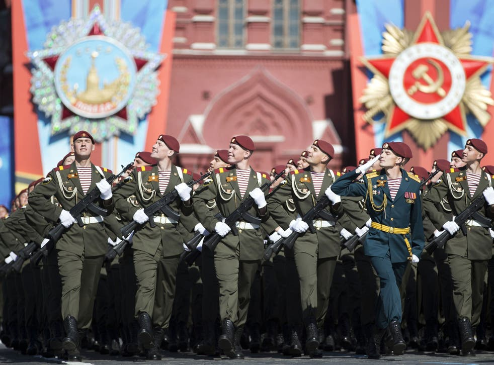 Thousands of Russian troops marched on Red Square in the annual Victory Day parade in a proud display of the nation's military might amid escalating tensions over Ukraine