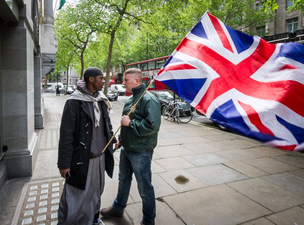 Paul Golding, right, leader of the patriot group 'Britain First', confronts an Islamist outside the High Commission of India in London