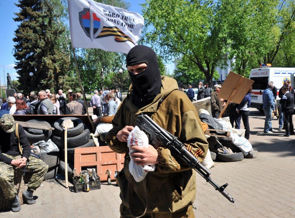 Armed pro-Russian militiants guard a barricade outside the regional state building in Kramatorsk, eastern Ukraine.