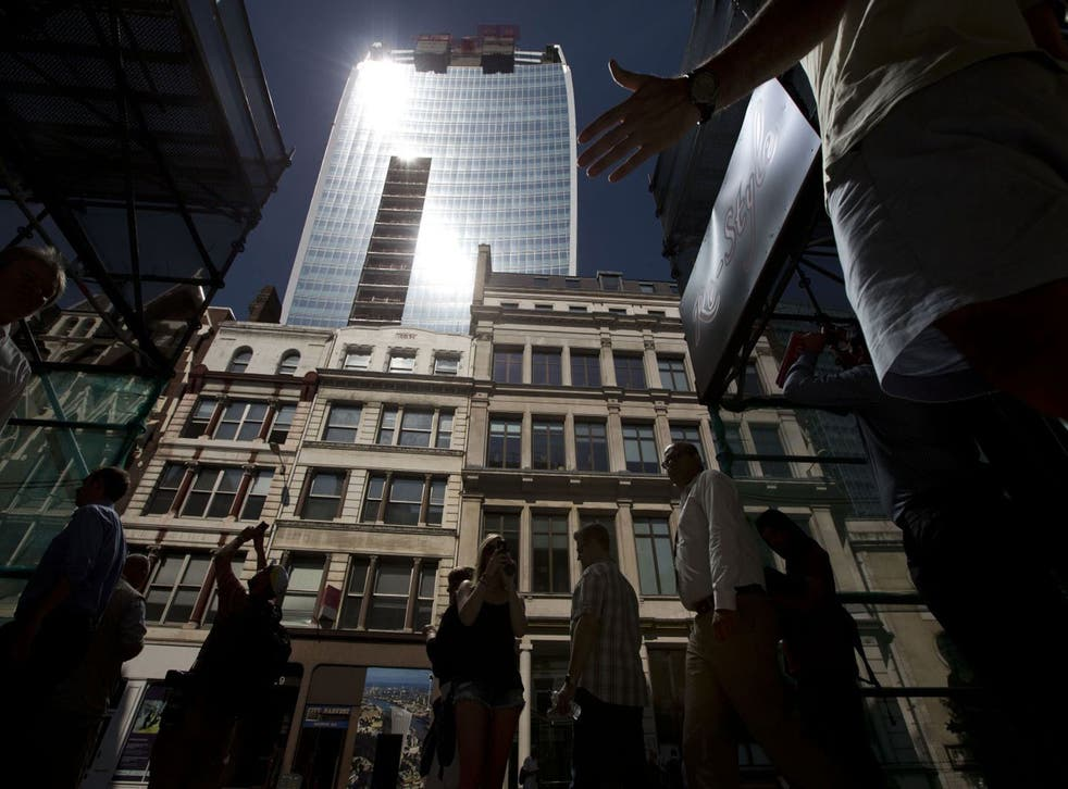 Intense sunlight reflects down towards street level off the 37-storey skyscraper at 20 Fenchurch Street in the City of London