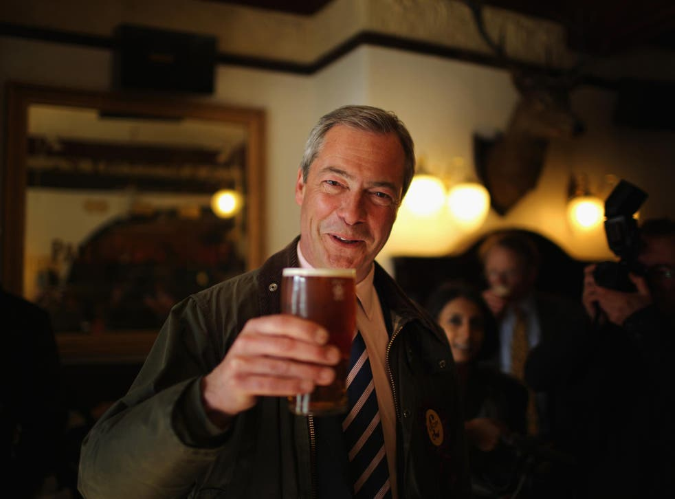 File: Nigel Farage with a pint