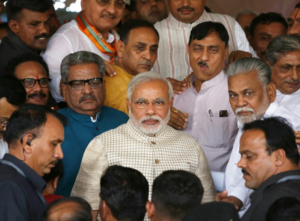 India's new Prime Minister Narendra Modi (centre), with his supporters yesterday at the BJP's Gujarat headquarters in Gandhinagar, is the first Indian leader to have been born after independence in 1947