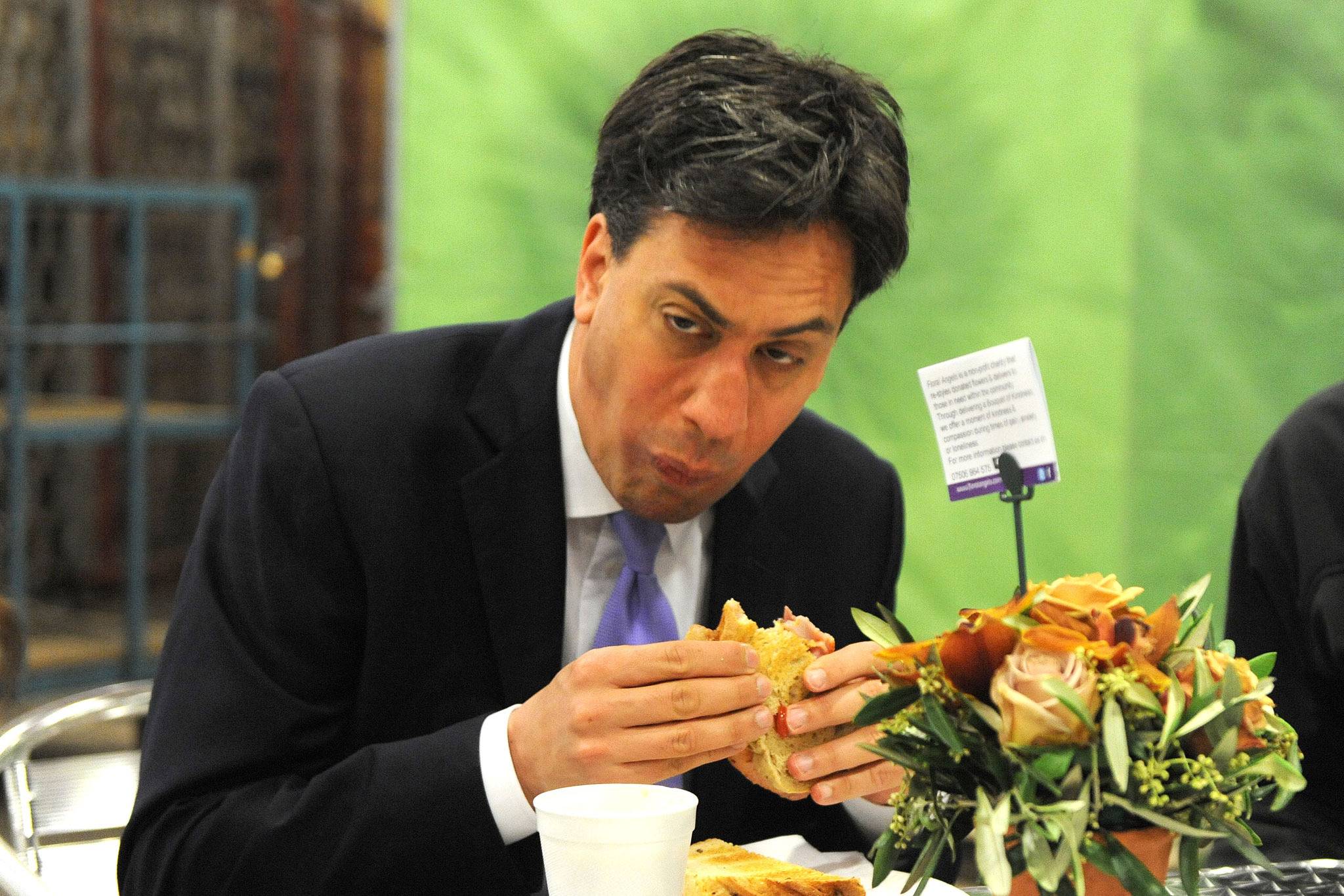 Ed Miliband Fails To Look Normal While Eating Bacon