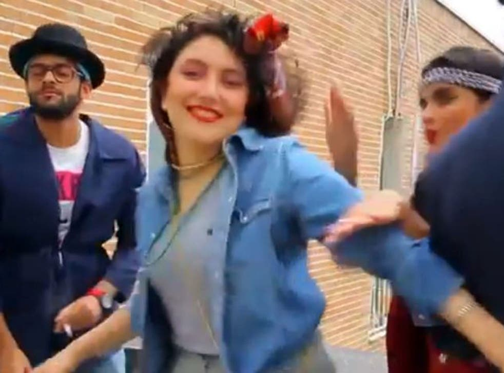"""In this frame grab taken from video posted to YouTube, people dance to Pharrell Williams' hit song """"Happy"""" on a rooftop in Tehran, Iran."""