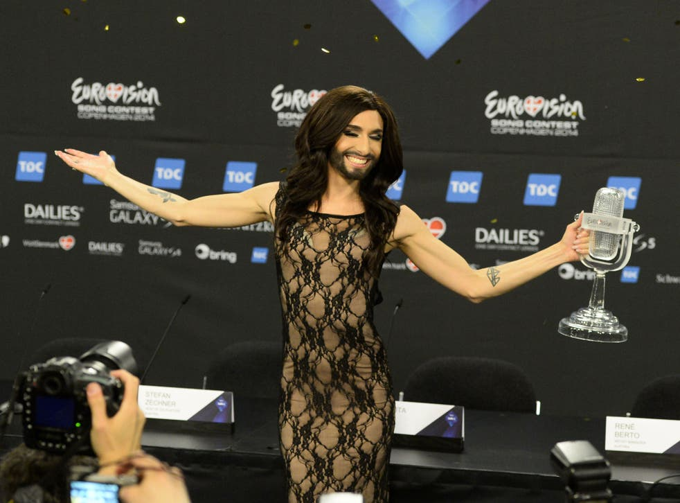 Conchita Wurst representing Austria poses with the trophy after a press conference after winning the Eurovision Song Contest 2014 Grand Final in Copenhagen
