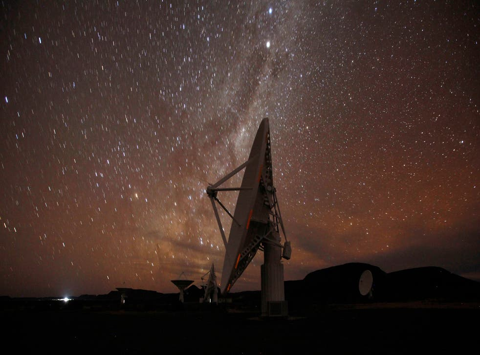 Night falls over radio telescope dishes of the KAT-7 Array at the proposed South African site for the Square Kilometre Array (SKA) telescope