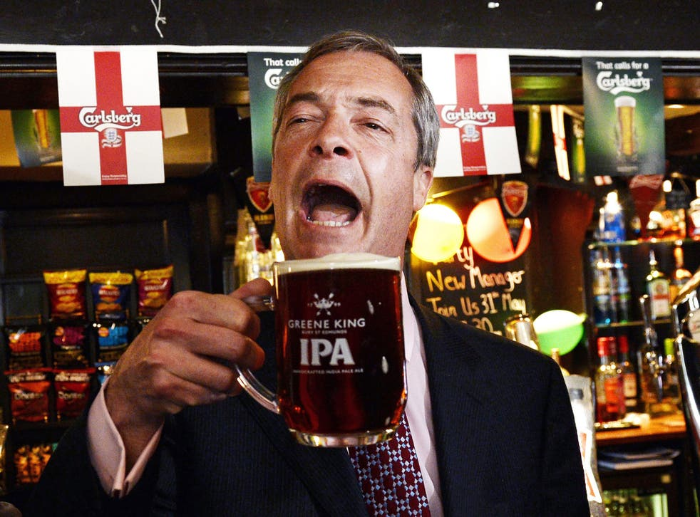 Nigel Farage celebrates with a pint after early local election results in the Hoy and Helmet pub in South Benfleet in Essex