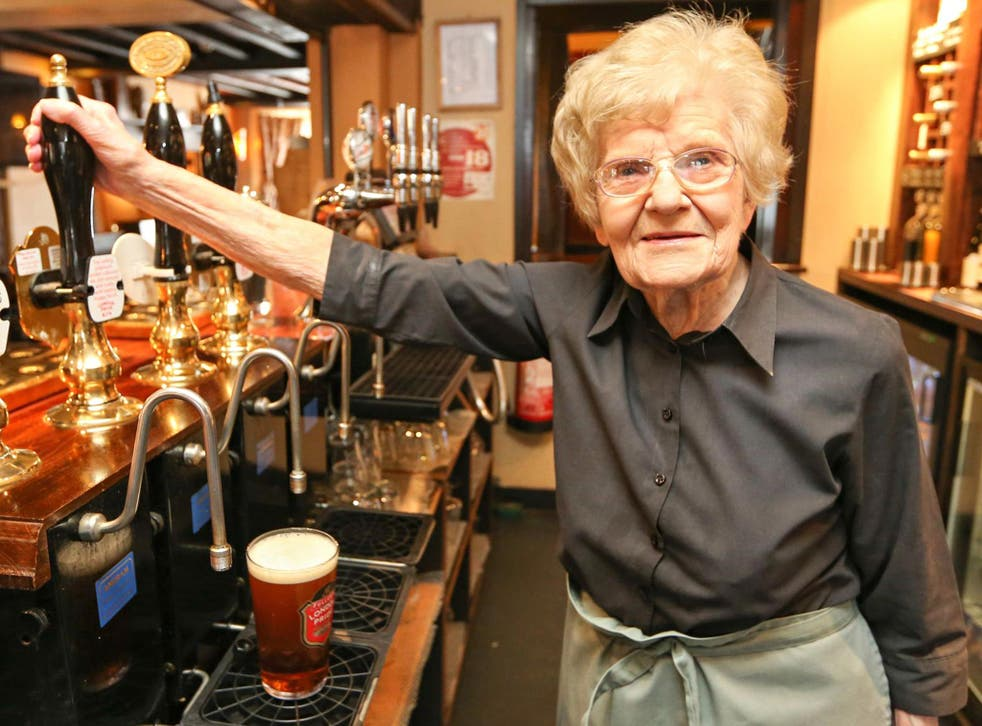 """One hundred years of age and a great-great-grandmother, Dolly, from Wendover, Buckinghamshire, is known as the """"oldest barmaid in the world"""". She has been pulling pints at the Red Lion Hotel for 75 years and still does three shifts a week. Dolly says she"""