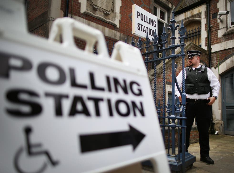 A police officer stands outside a polling station