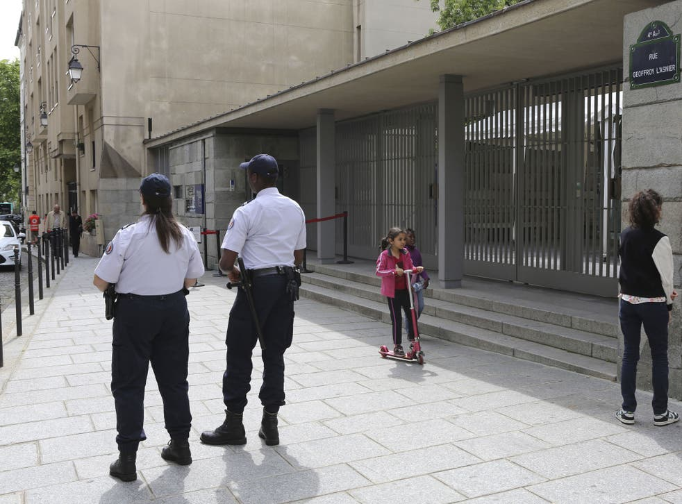 Two police officers stand guard in front of the Shoah Memorial in Paris. French interior minister Bernard Caseneuve ordered police around France to increase security at Jewish houses of worship and other Jewish establishments, according to a statement on