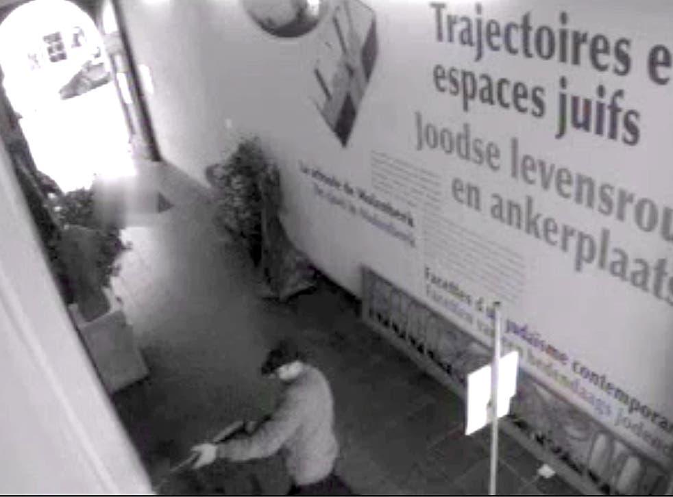 A security tape shows the attacker brandishing a Kalashnikov assault rifle