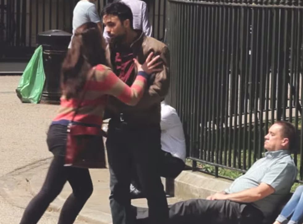 A female attacker pushes her victim against park railings