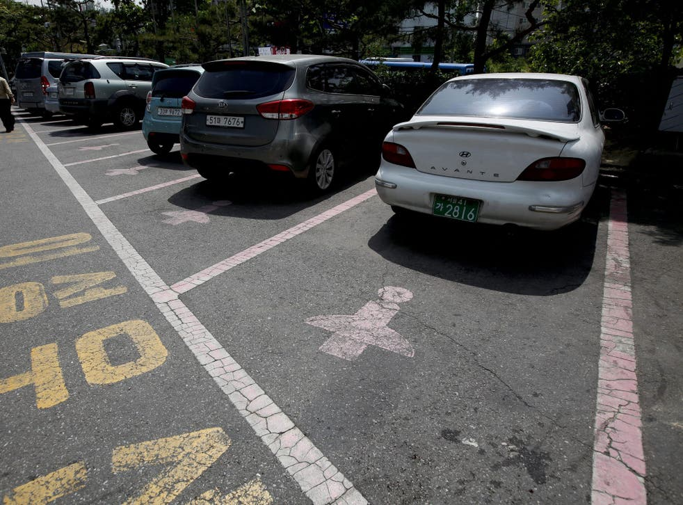 Pink outlines and a figure wearing a skirt mark the 'Women Only' parking slots at the Seodaemun office district in Seoul, South Korea