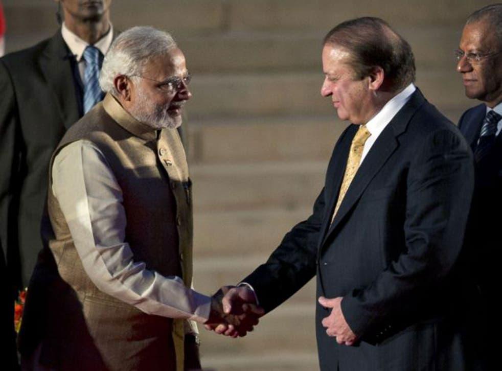 Indian Prime Minister Narendra Modi and his Pakistani counterpart Nawaz Sharif shake hands at Modi's inauguration