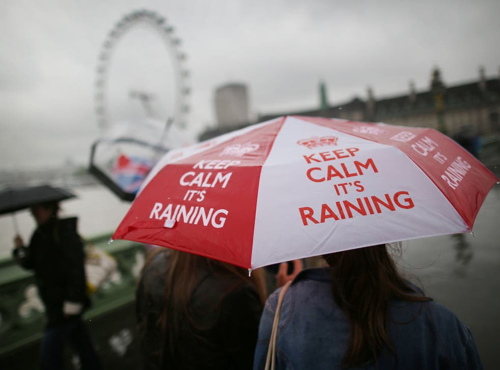 A girl carries a 'Keep calm it's raining' umbrella on Westminster Bridge on May 28, 2013 in London, England. Heavy rain is falling in London and the south east after a warm and sunny bank holiday weekend.