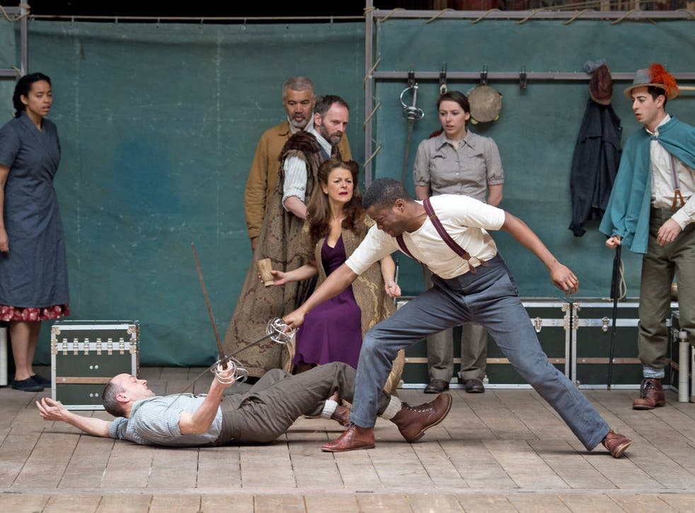 Members of the cast of a new touring production of William Shakespeare's 'Hamlet' perform at the Globe theatre in London