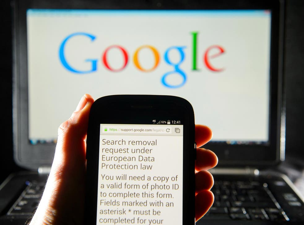 A Google search removal request on the screen of a smartphone