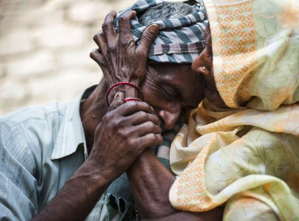 Sohan Lal, father and uncle of Murti and Pushpa, the two girls who were raped and hanged in Katra Sadatganj in Uttar Pradesh, is comforted by his mother