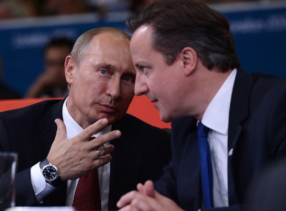 David Cameron talks with Russian president Vladimir Putin