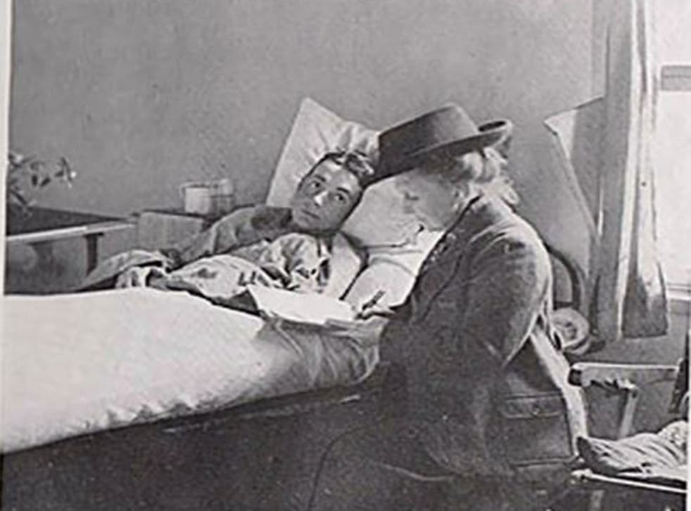 May Bradford writing a letter for an injured soldier in a French hospital