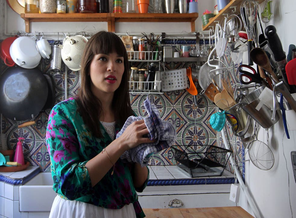 British chef and author, Rachel Khoo poses on April 2, 2012 in her micro-restaurant named 'La petite cuisine