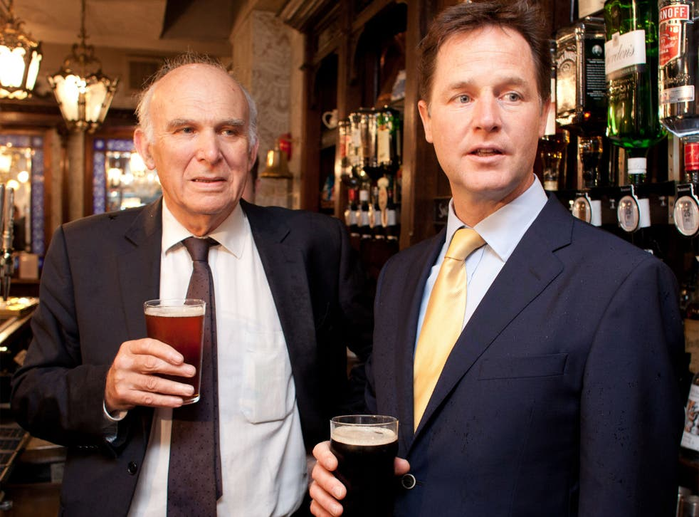 Vince Cable and Nick Clegg enjoy a drink at the Queens Head Pub