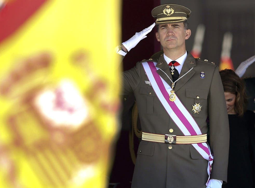 Spanish Crown Prince Felipe salutes at the national flag during a military ceremony of the San Hermenegildo Order