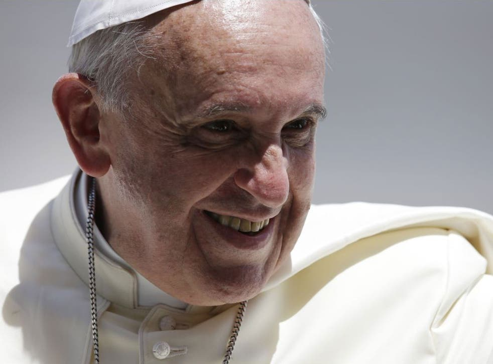 Pope Francis' new financial watchdog board includes a woman for the first time