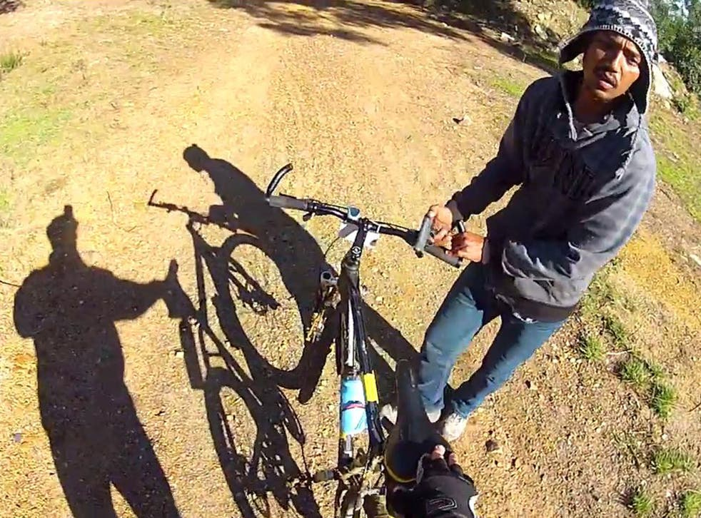 The man was riding his bike while wearing a GOPRO camera on his helmet when the assailant armed with a gun ran up and stopped him in his tracks.