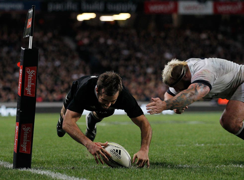Conrad Smith scores the match-winning try for New Zealand in their 20-15 victory over England