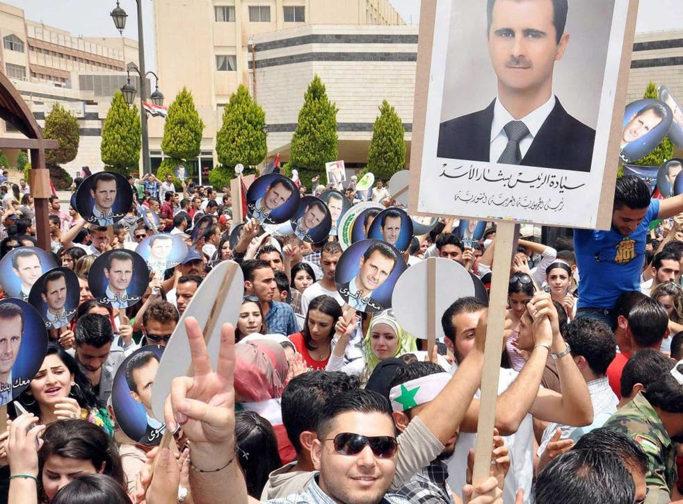 Zero tolerance: Bashar al-Assad supporters turn out to mark his election to a third seven-year term as president