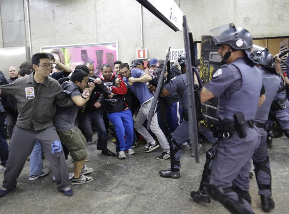Kick-off: Police clash with metro workers in Sao Paulo during Friday's strike