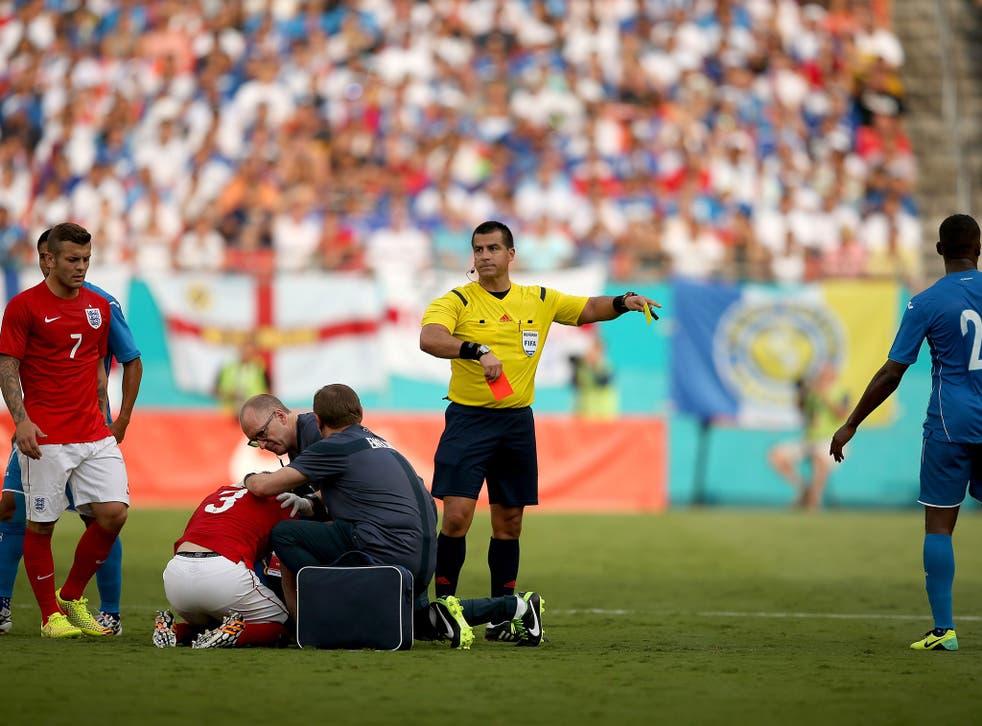 Ricardo Salazar sends off Brayan Beckeles of Honduras for a challenge on Leighton Baines of England during the International Friendly match between England and Honduras