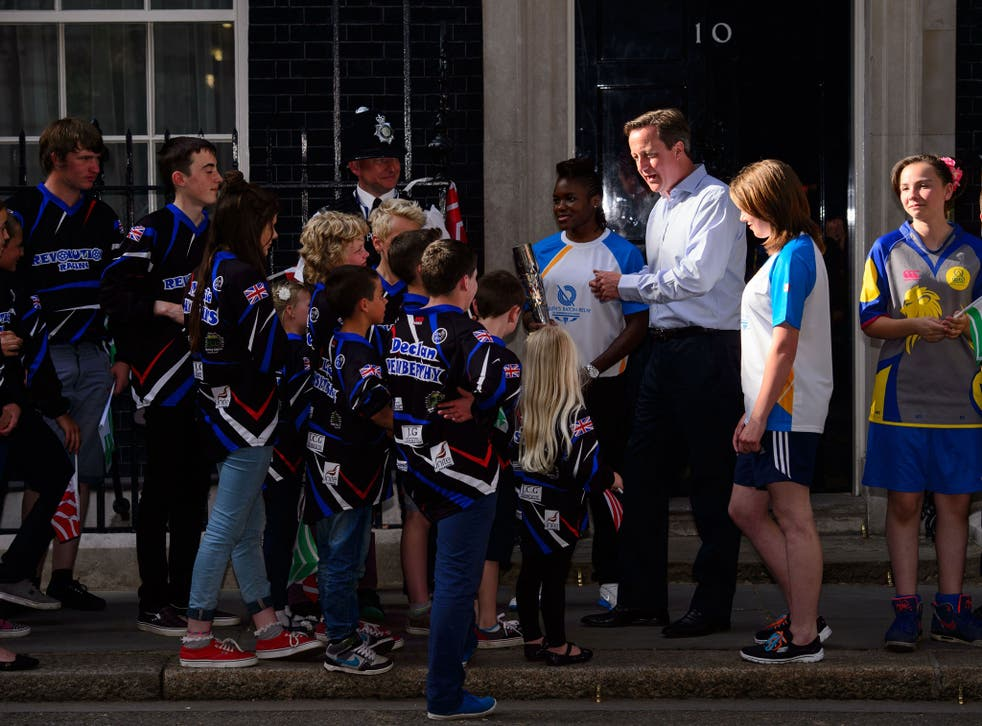 David Cameron greets children carrying the Glasgow 2014 Queen's Baton as the relay arrives at Number 10