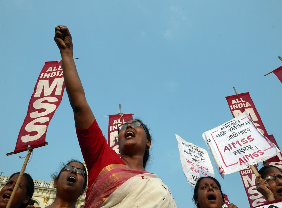 Indian activists from the Social Unity Center of India (SUCI) shout slogans against the state government in protest against the gang rape and murder of two girls in the district of Badaun in the northern state of Uttar Pradesh and recent rapes in the east