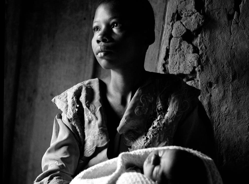 19 year-old Brigitte with her baby boy Damas, conceived when she was raped. Damas died shortly after this was taken. Photograph by Fiona Lloyd-Davies