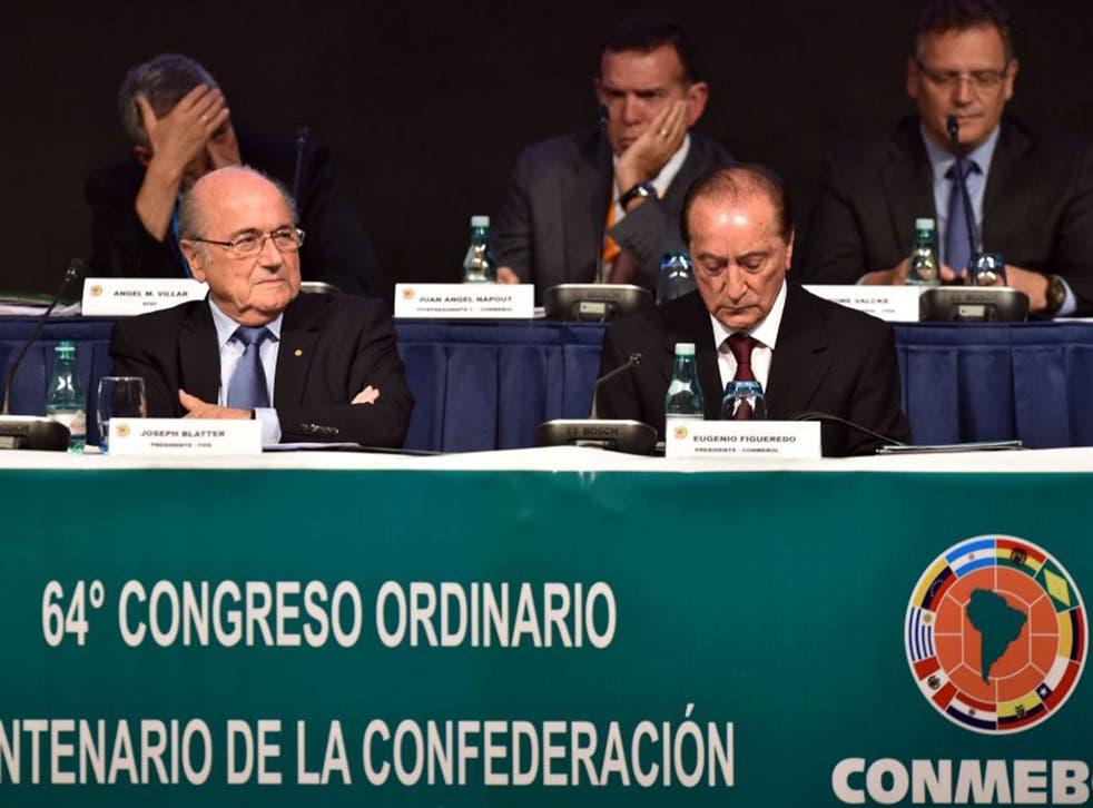 The Fifa president Sepp Blatter, left, holds court in Sao Paulo