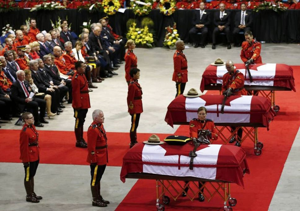 Canada shooting: Thousands of Mounties attend funeral of three