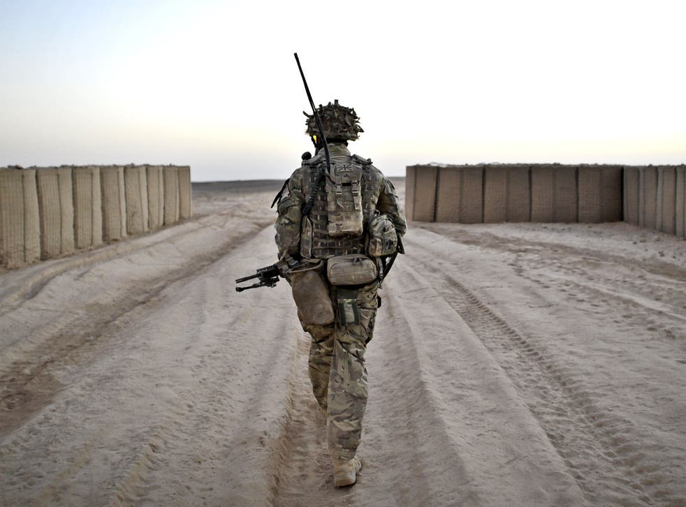 A soldier conducting a dawn foot patrol in Helmand Province, Afghanistan