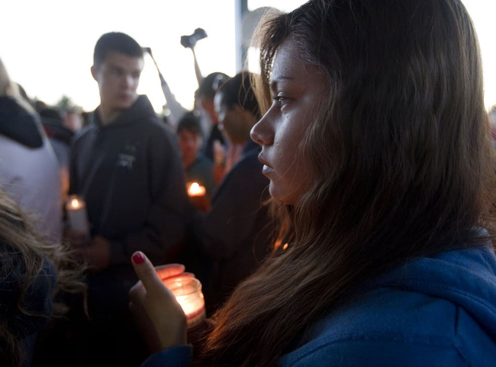 A student holds a candle for Emilio Hoffman the victim of today's school shooting at a vigil on June 10, 2014 in Troutdale, Oregon. A gunman walked into Reynolds High School with a rifle and shot 14 year old Hoffman to death on Tuesday, in what is the the third outbreak of gun violence in a U.S. school in less than three weeks.